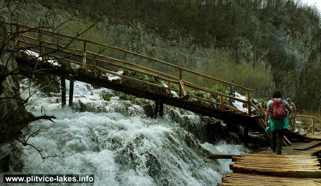 Crossing waterfalls at Plitvice Lakes