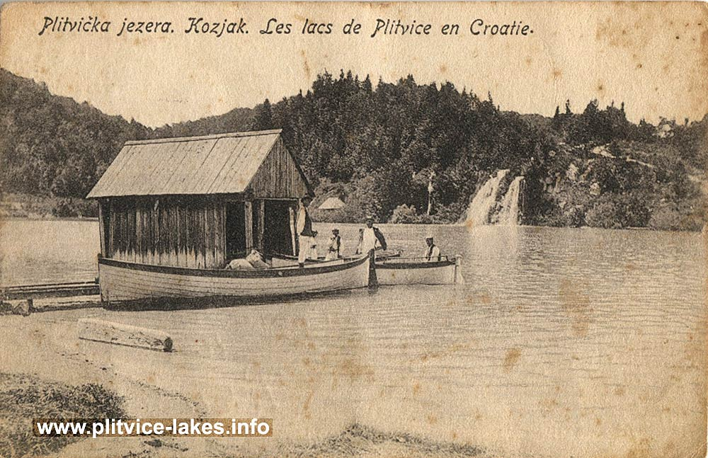 Small wooden pier, boats and waterfall at Kozjak Lake, Plitvice in 1900s
