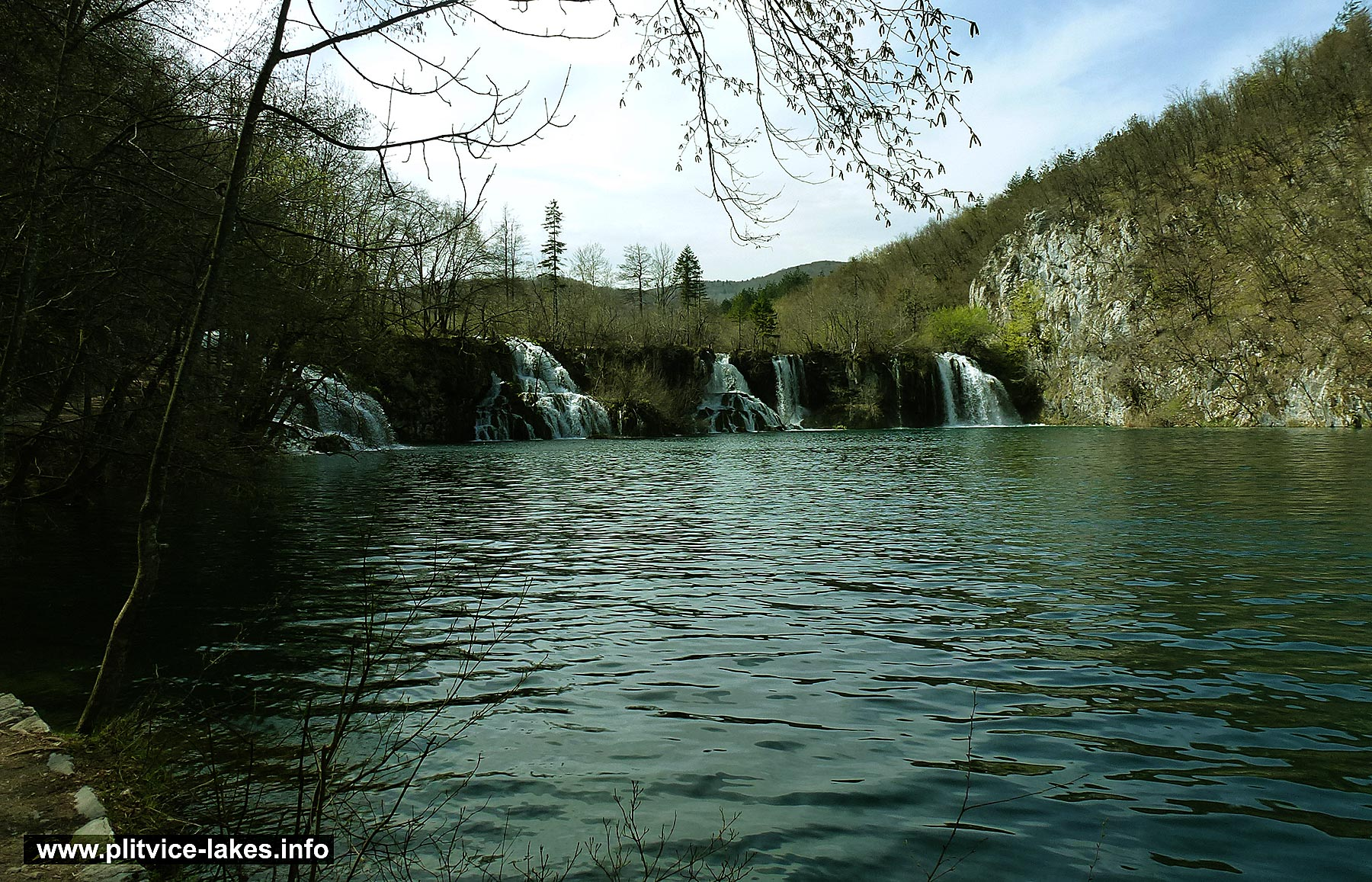 Walking along Milanovac lake with views over waterfalls